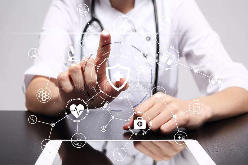 Medicine doctor with modern computer, virtual screen interface and icon medical network connection. health care concept. Medicine doctor with modern computer stock photo