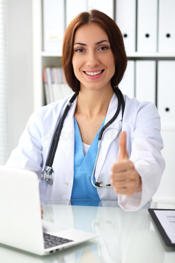 Medicine doctor show OK sign with thumb up close up. Success and high level service in health care, best treatment and. Customer loyalty and physical concept stock photos