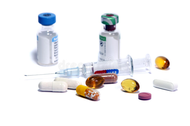 Medicine doping. Syringe and medicine bottles as symbol of doping stock photo