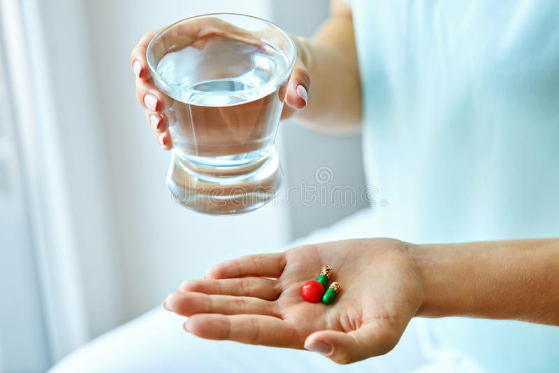 Medicine. Female Hand Holding Vitamins And Pills. Health Care. Medicine. Closeup Of Female Hand Holding Colorful Vitamins, Pills, Medication. Beautiful Woman royalty free stock image