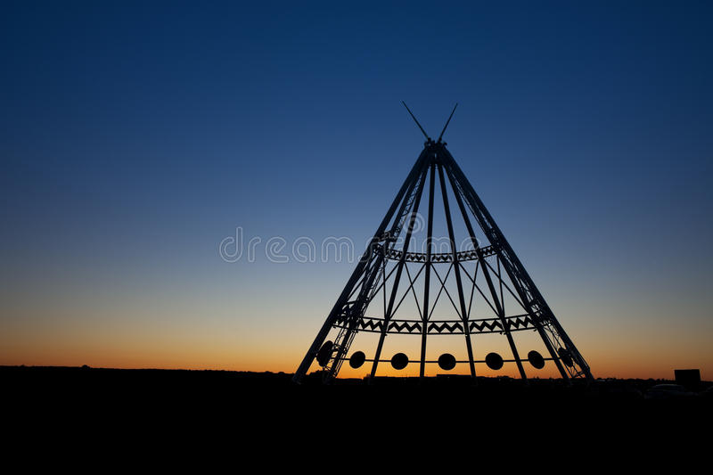 Medicine Hat Teepee at Sunset. The worlds largest teepee is located in Medicine Hat, Alberta, Canada. Originally constructed for the Calgary 1988 Winter Olympics stock photo