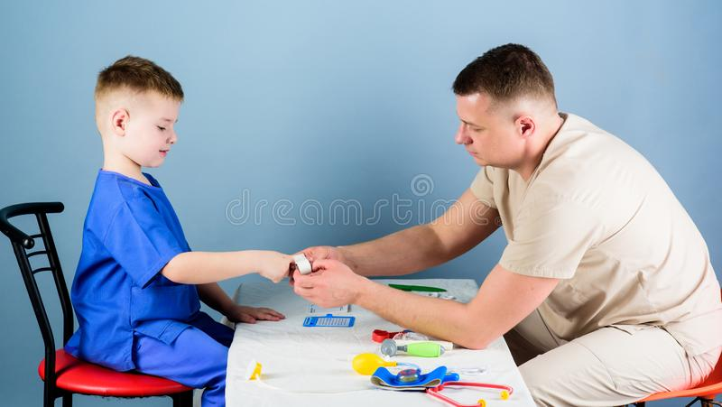 Medicine and health. small boy with dad play. pediatrician intern. nurse laboratory assistant. happy child with father. With stethoscope. father and son in royalty free stock photo