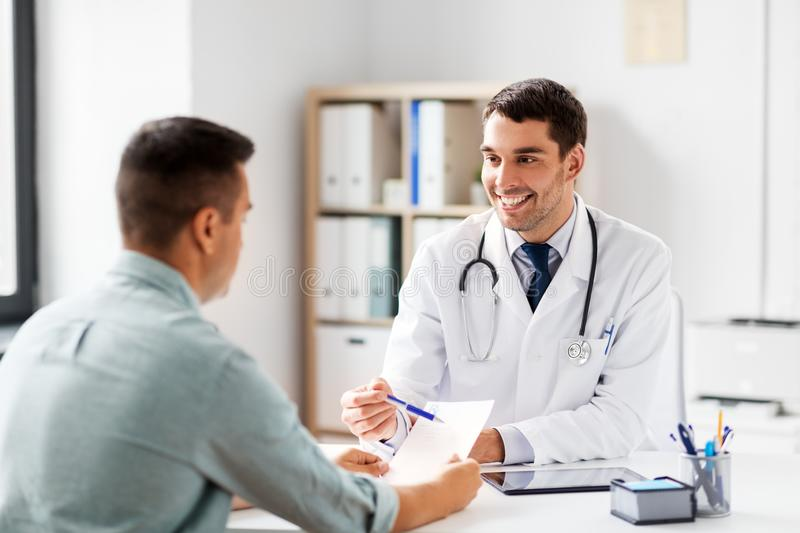 Doctor showing prescription to patient at hospital royalty free stock image