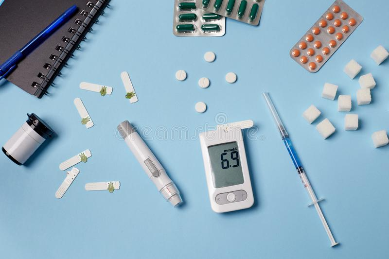 Medicine, healthcare, technology and online pharmacy concept. A diabetic measures your blood glucose royalty free stock image