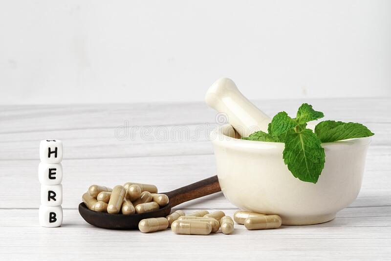 Medicine herbal capsule, vitamin, mineral, drug with herbs leaf royalty free stock photos