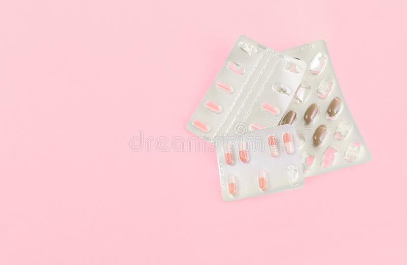 Medicine pills, capsules on pink background.Concept of medicine.Medicines for the treatment of diseases, viruses, autumn cold. Season, beriberi, hypothermia royalty free stock photo