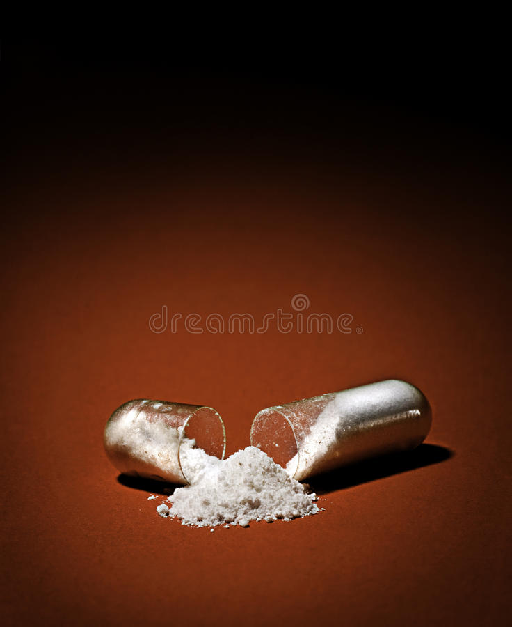 Medicine pills. Containing white powder stock photos