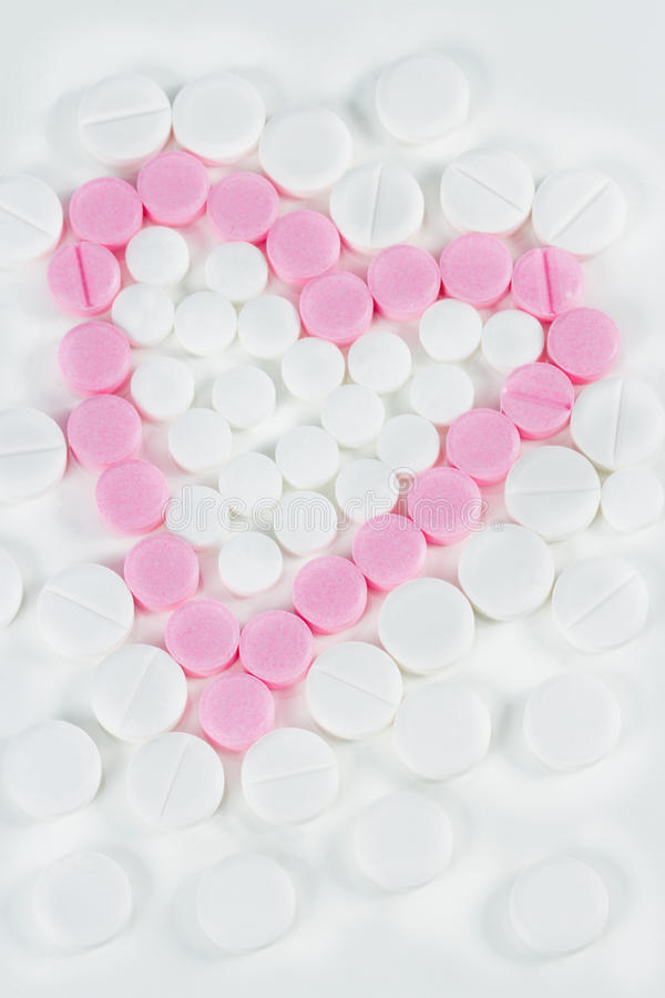 Medicine pills shaped as a heart stock image