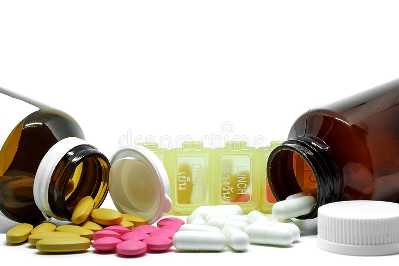 Medicine pills, vitamins, bottles and box on white background with copy space stock photo