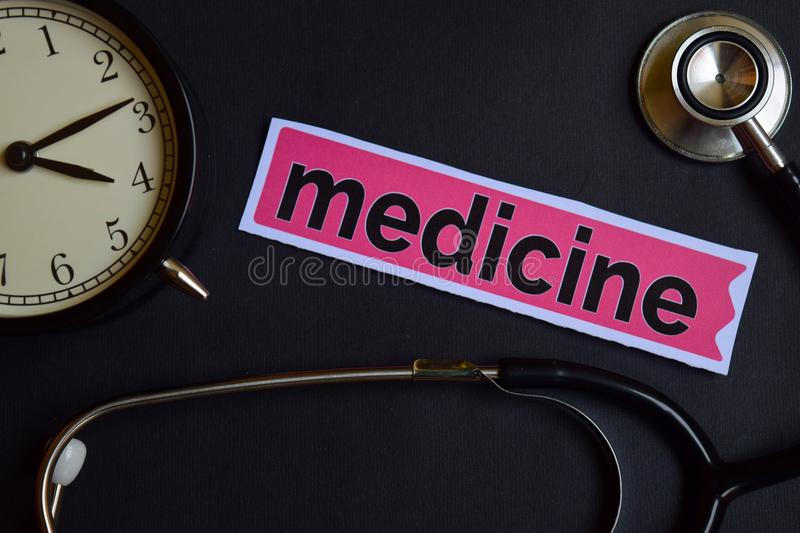 Medicine on the print paper with Healthcare Concept Inspiration. alarm clock, Black stethoscope. stock photography