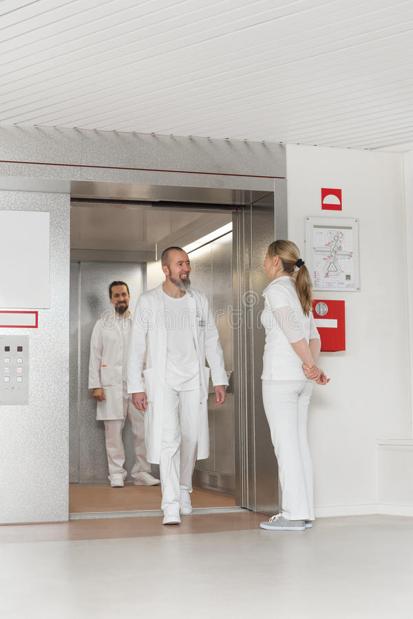 Medicine staff in front of an elevator royalty free stock image