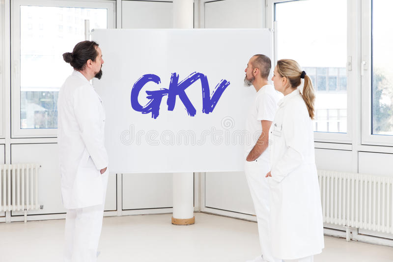 Medicine staff in front of a white board royalty free stock images