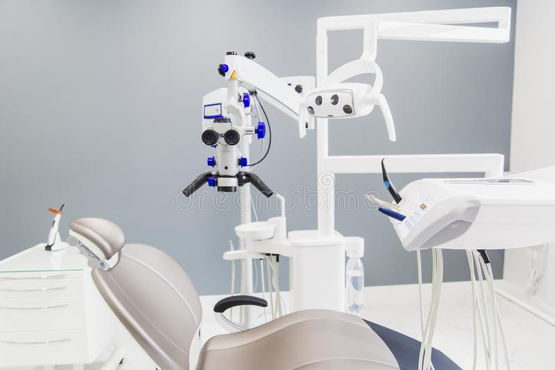 Medicine, stomatology, dental clinic office, medical equipment and instruments for dentistry - dentistry equipment, gray chair, mi royalty free stock photos