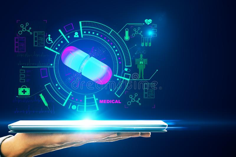 Medicine and technology concept. Hand holding tablet with creative glowing blue medical interface on dark background stock illustration
