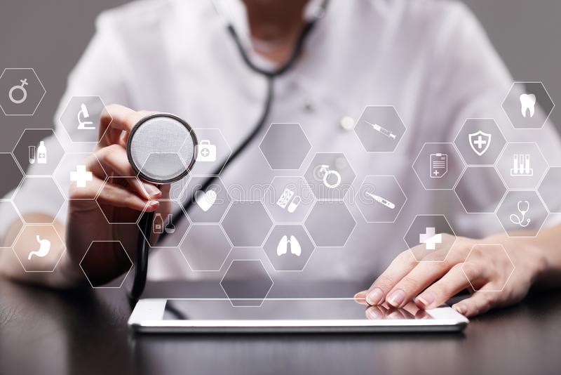 Medicine technology and healthcare concept. Medical doctor working with modern pc. Icons on virtual screen. Medicine technology and healthcare concept. Medical stock photo