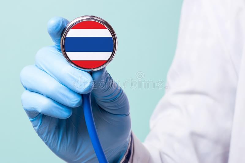 Medicine in Thailand is free and paid. Expensive medical insurance. Treatment of disease at the highest level Doctor. Holding a stethoscope in his hand royalty free stock photography