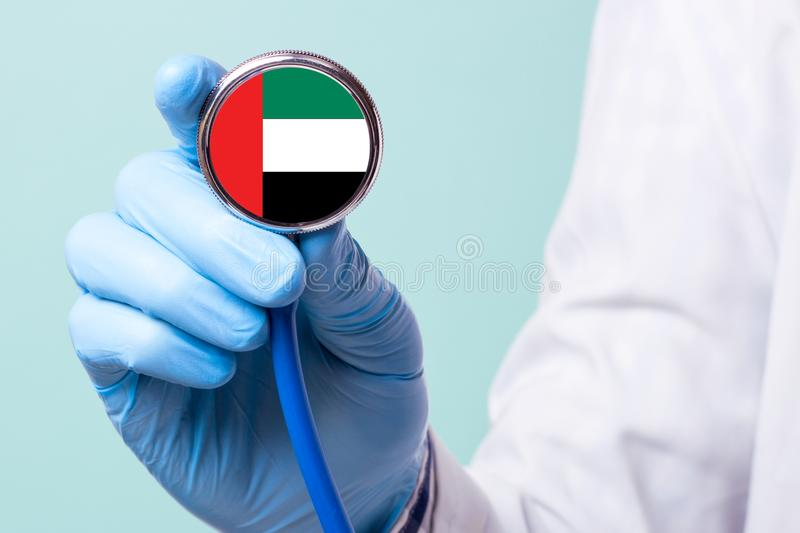Medicine in United Arab Emirates is free and paid. Expensive medical insurance. Treatment of disease at the highest level. Doctor holding a stethoscope in his royalty free stock image