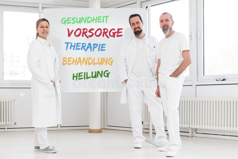 Medicine workers in front of white board stock photo