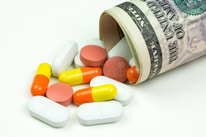 Medicines, capsules and pills lying on money, on white background. Medicines, capsules and pills lying on dollar bills, on white background vector illustration