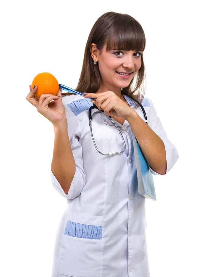 medicinskt tecken Doktor eller sjuksköterska för ung kvinna med kopieringsutrymme för text arkivbild