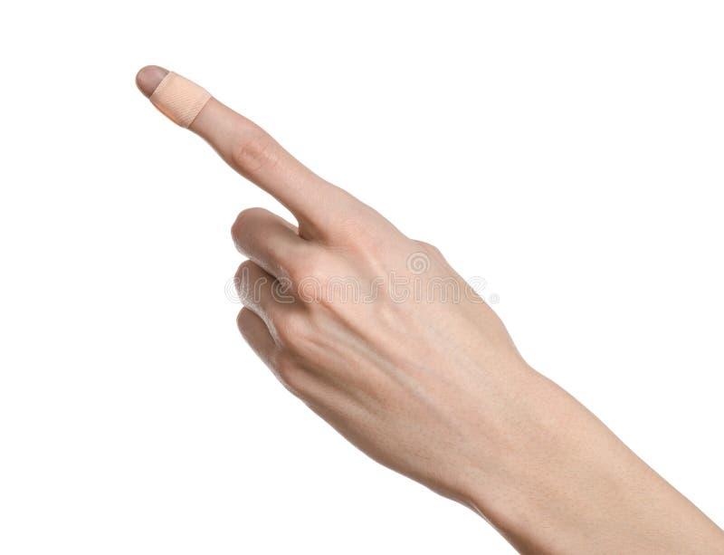 Medicinskt tema: för en mans hand limmad medicinsk advertizing för murbrukförsta hjälpenmurbruk på en vit bakgrund fotografering för bildbyråer