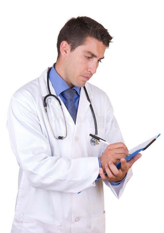 Medico amichevole che cattura le note fotografia stock libera da diritti