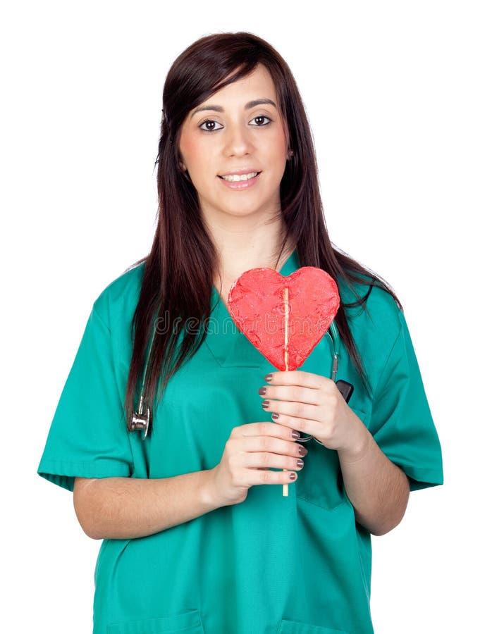 Medico attraente del brunette con un lollipop fotografia stock