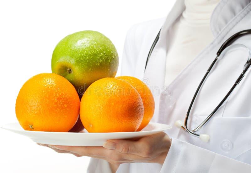 Medico che prescrive cibo sano fotografia stock