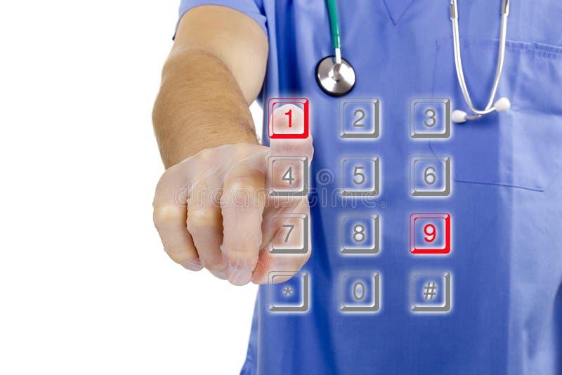 Medico compone il numero 911 immagini stock