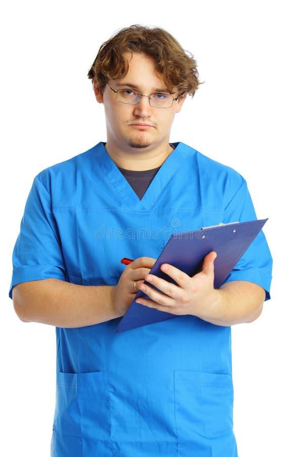 Medico con il blocchetto per appunti fotografie stock