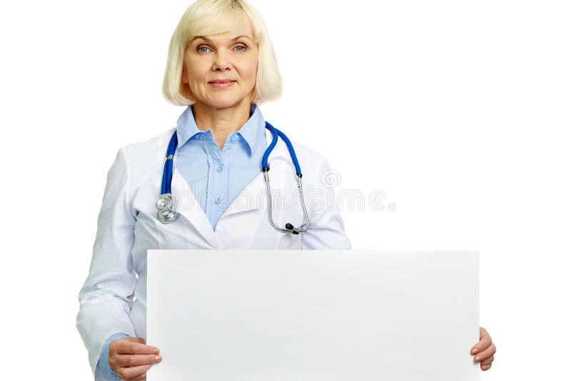 Medico con il cartello immagine stock