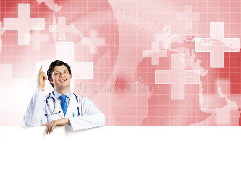 Medico con l'insegna fotografia stock