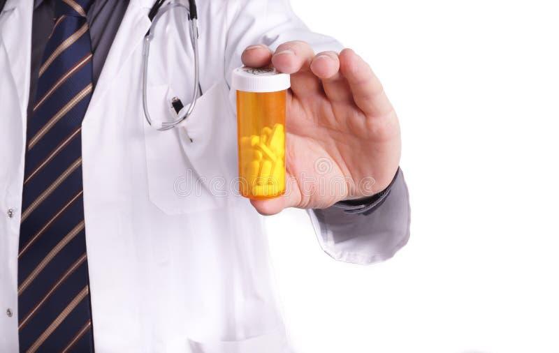 Medico con medicina a disposizione fotografia stock