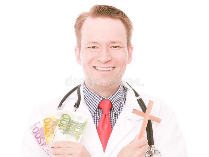Medico cristiano felice con soldi fotografie stock libere da diritti