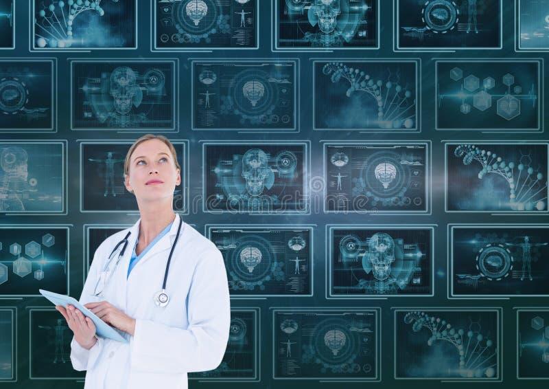 Medico della donna che cerca contro il fondo con le interfacce mediche fotografie stock