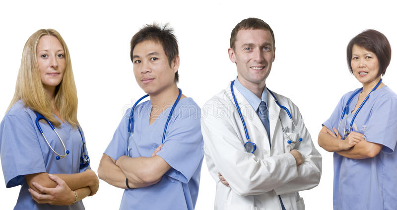 Medico ed il suo gruppo di medici fotografie stock libere da diritti
