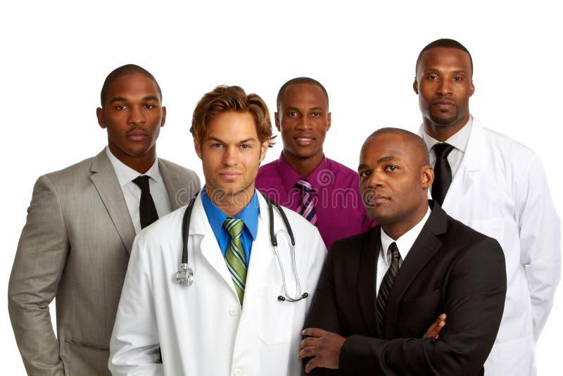 Medico ed uomini di affari isolati su fondo bianco fotografia stock