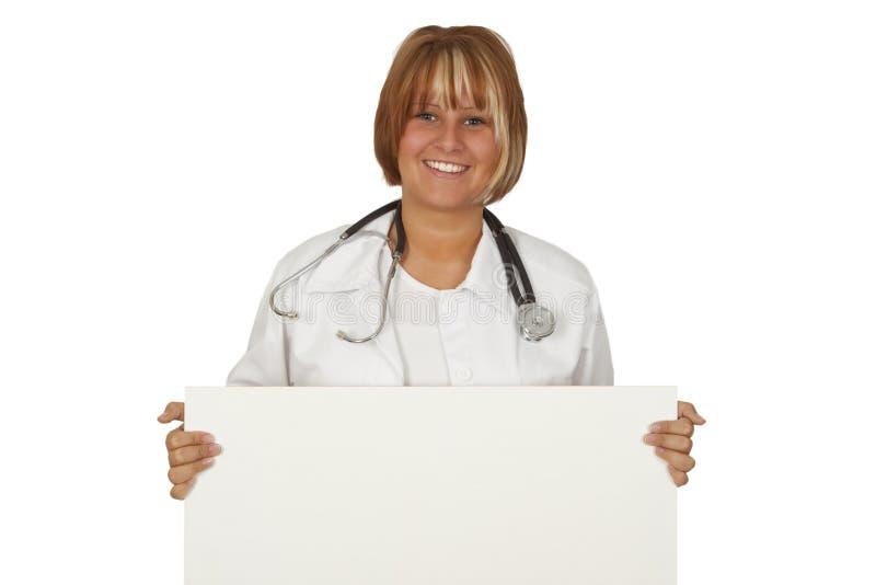 Medico femminile con una bandiera immagini stock libere da diritti