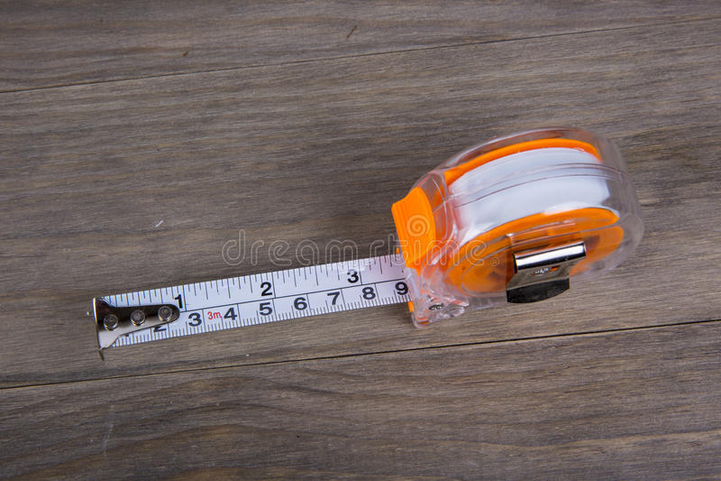 Medida de fita, construção que estima ferramentas foto de stock