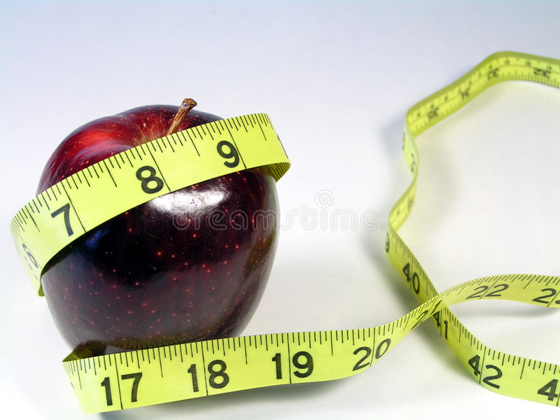 Medida de fita vermelha da maçã e do amarelo imagens de stock