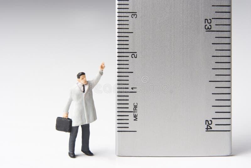 Medida de um homem imagens de stock