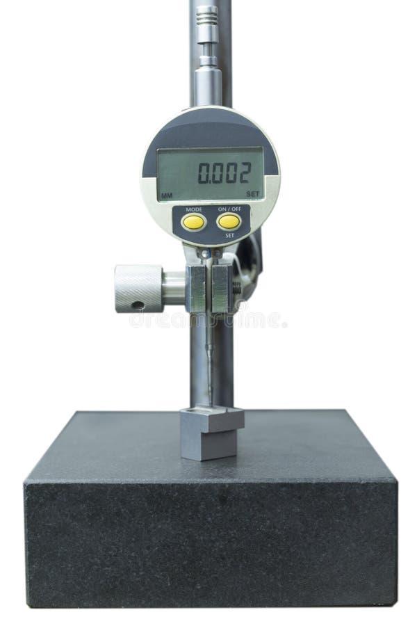 Medida del indicador del dial de Digitaces en aislante de la tabla del granito fotos de archivo