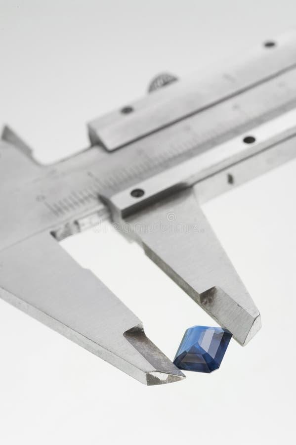 Gema y calibrador azules del topaz fotografía de archivo libre de regalías