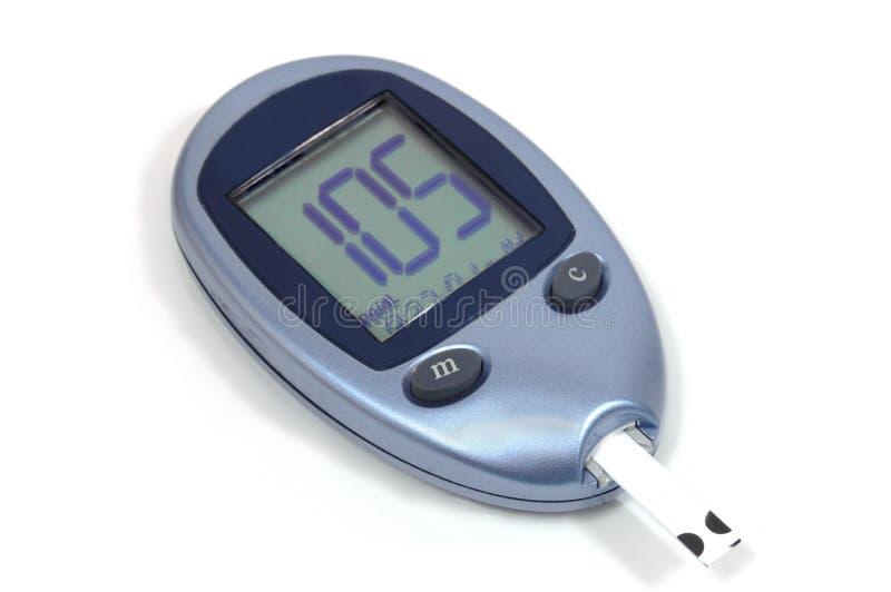 Medidor de glicose de sangue imagem de stock