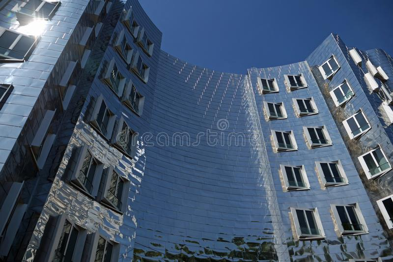 Duesseldorf, Germany, Europe; August 4, 2019: View on the backside of the stainless steel New Zollhof Building from Frank O. Gehry. In the Medienhafen Media stock photos