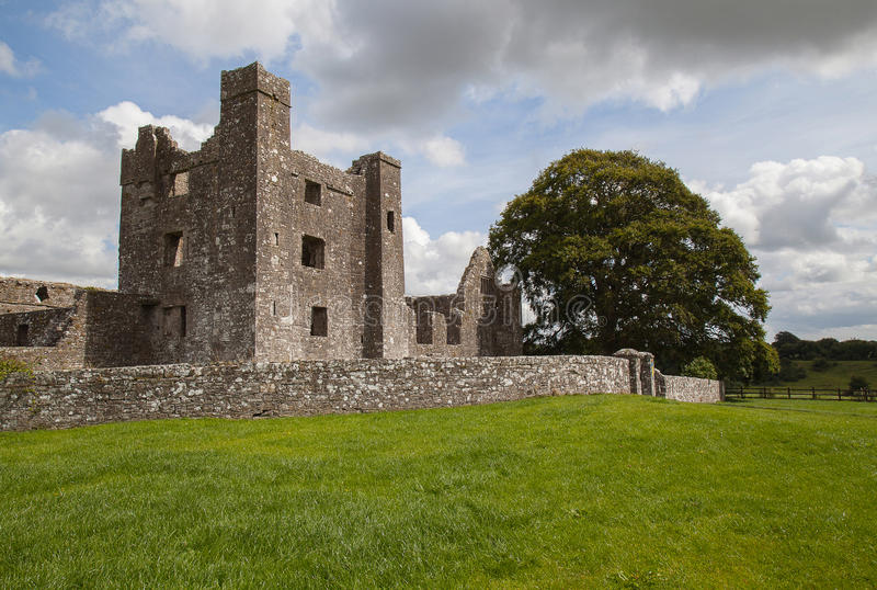Medieval abbey ruins in rural area. stock images