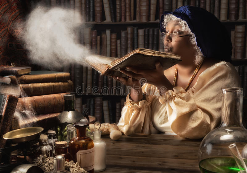 Medieval alchemist. Blowing dust off the old books in her laboratory