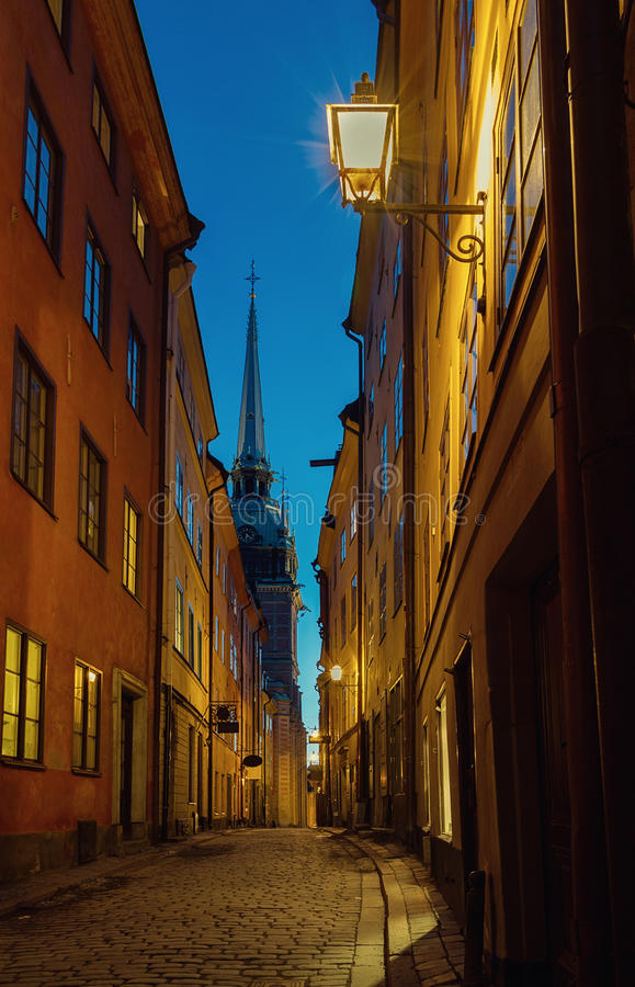Medieval alley at night in Stockholm Gamla stan. stock photo
