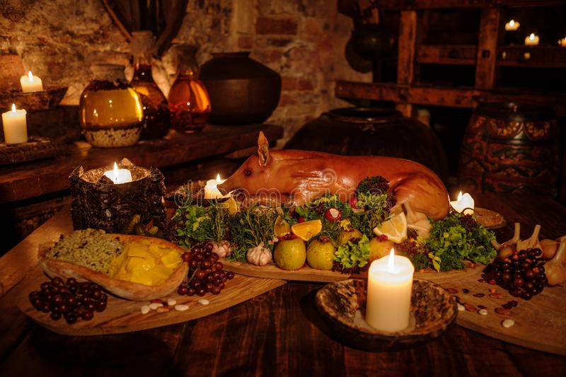 Medieval ancient kitchen table with typical food in royal castle. royalty free stock photography