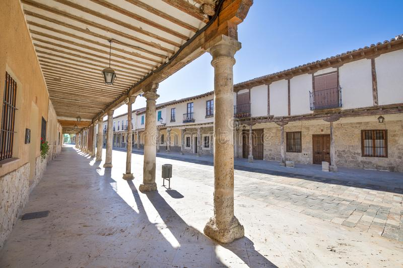 Medieval arcaded street in Ampudia old village. Arcaded buildings, in medieval street, landmark and monument from seventeenth century, in Ampudia village royalty free stock image